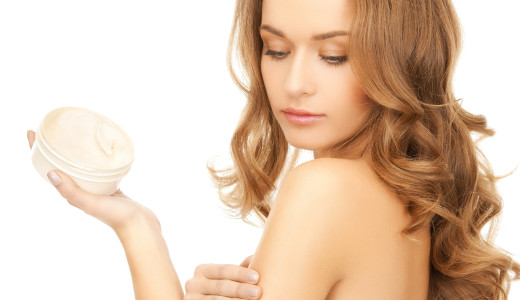 bigstock-beautiful-woman-applying-cream-46157362